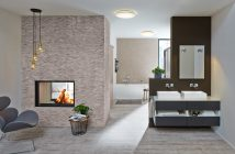"""Badezimmer mit Badewanne """"Firenze"""" und Aufsatzwaschbecken """"Turano"""" mit integriertem Kaminzimmer."""
