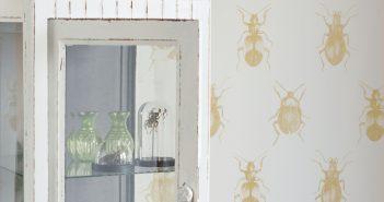 Tapete mit gelben Käfern